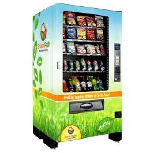 A picture of one of our vending machines. Very colorful with light green. We have all options you need in a vending machine. We are your go to for Miami healthy vending service.