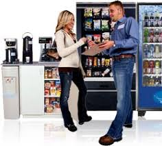A picture of two people talking in front of a snack vending machine. Illustrating servicing of the machine. When it comes to our services we make sure we speak with our customers and fulfill any needs they have. We fill our machines with exactly what our customers want. Our goal is great customer service. So we listen to our customers, make sure our machines are top notch and provide our customers with the snacks they want. We take vending services to another level. Our machines listen and most importantly we listen. We are your go to for vending Miami and south florida.