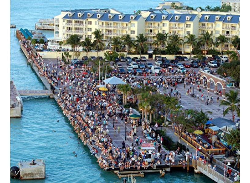 Things to do in Miami, Florida. A picture of Mallory Square in Key West. One of the nicest sunsets in the U.S. . This is one of the best things to do in Miami. It is about 3 hours away but worth it.